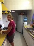 Deidre making Pico in the kitchen