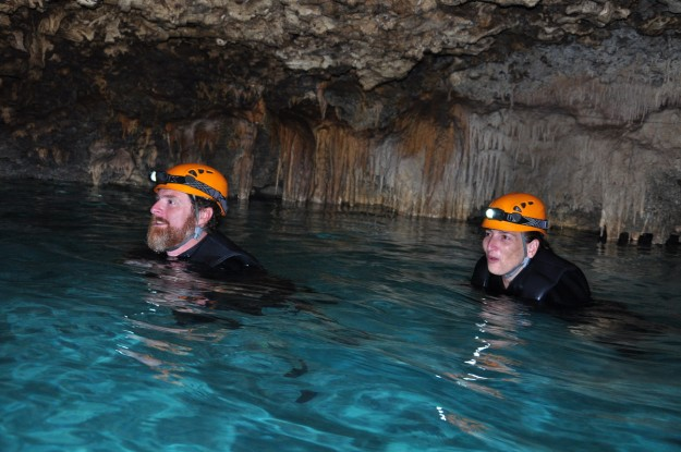 Swimming through the caves of Rio Secreto