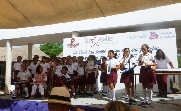 Children singing at Gratitude Day at Pelopidas School
