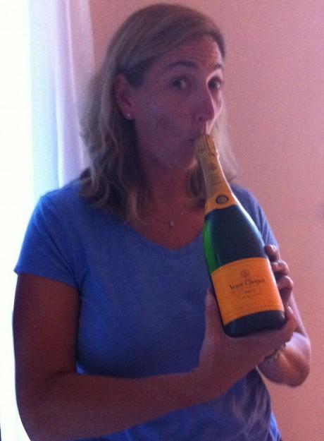 Deidre drinking champagne